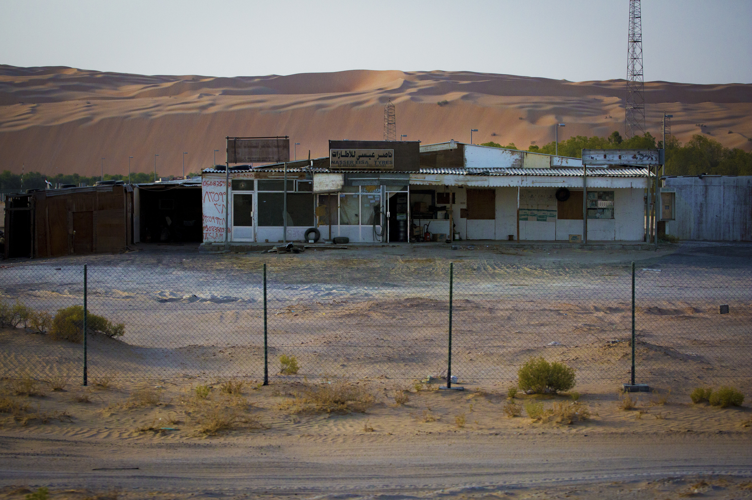 An abandoned shed along the Liwa desert.jpg