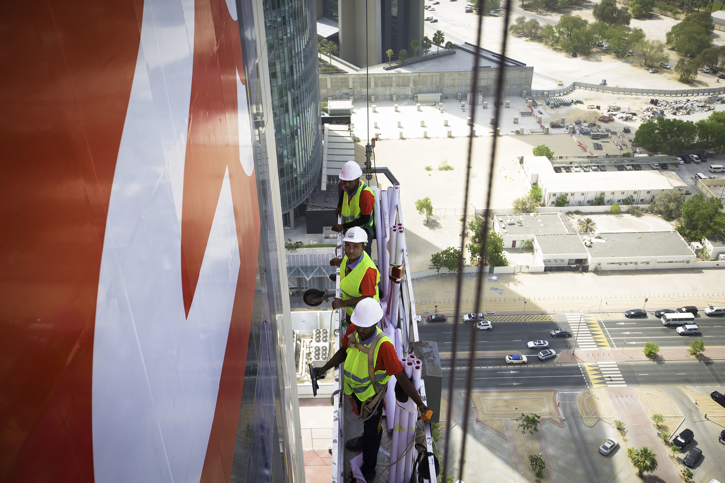ENG applicators putting up an advert on Dubai's Warwick Hotel.jpg