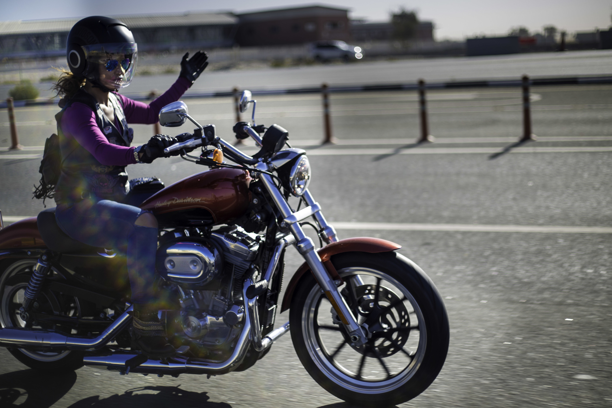 Sun glints as the women hit the road on International Female Ride Day.jpg