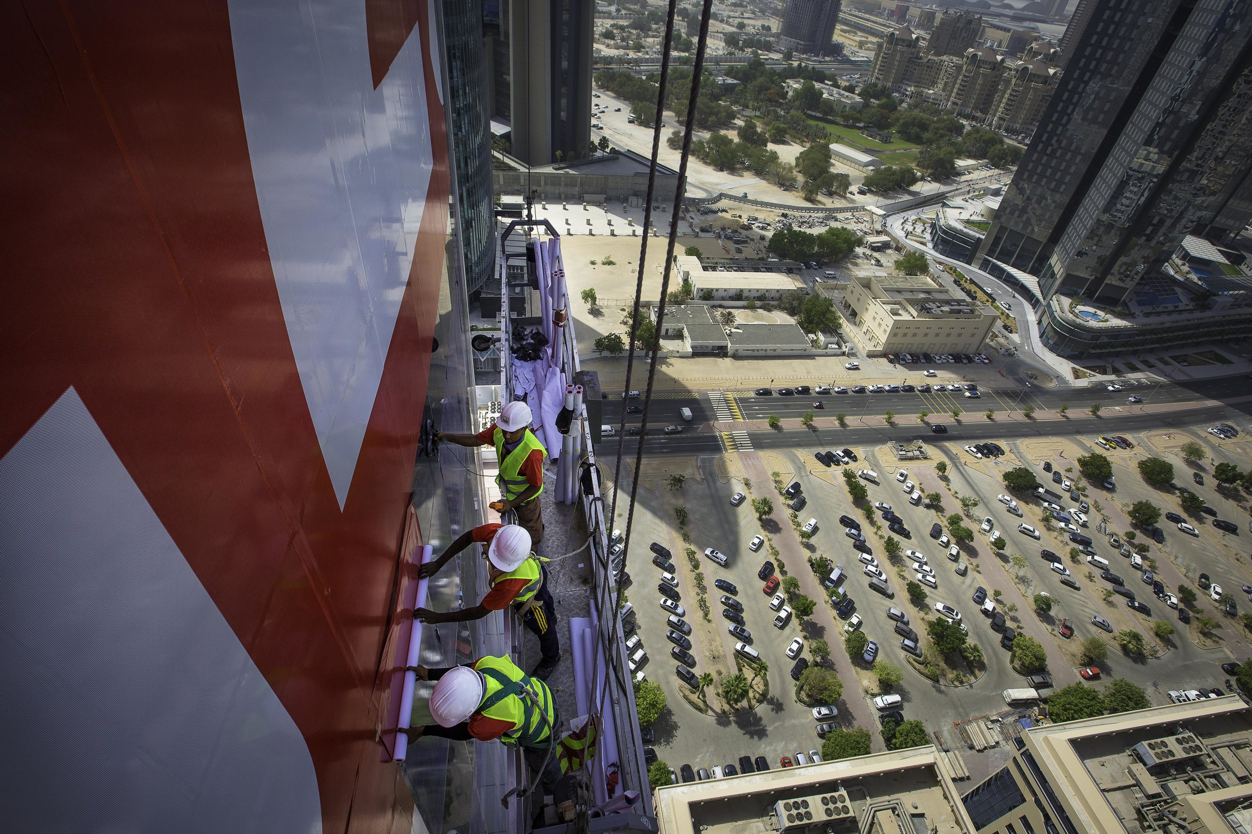 ENG applicators putting up an advert on Dubai's Warwick Hotel (2).jpg