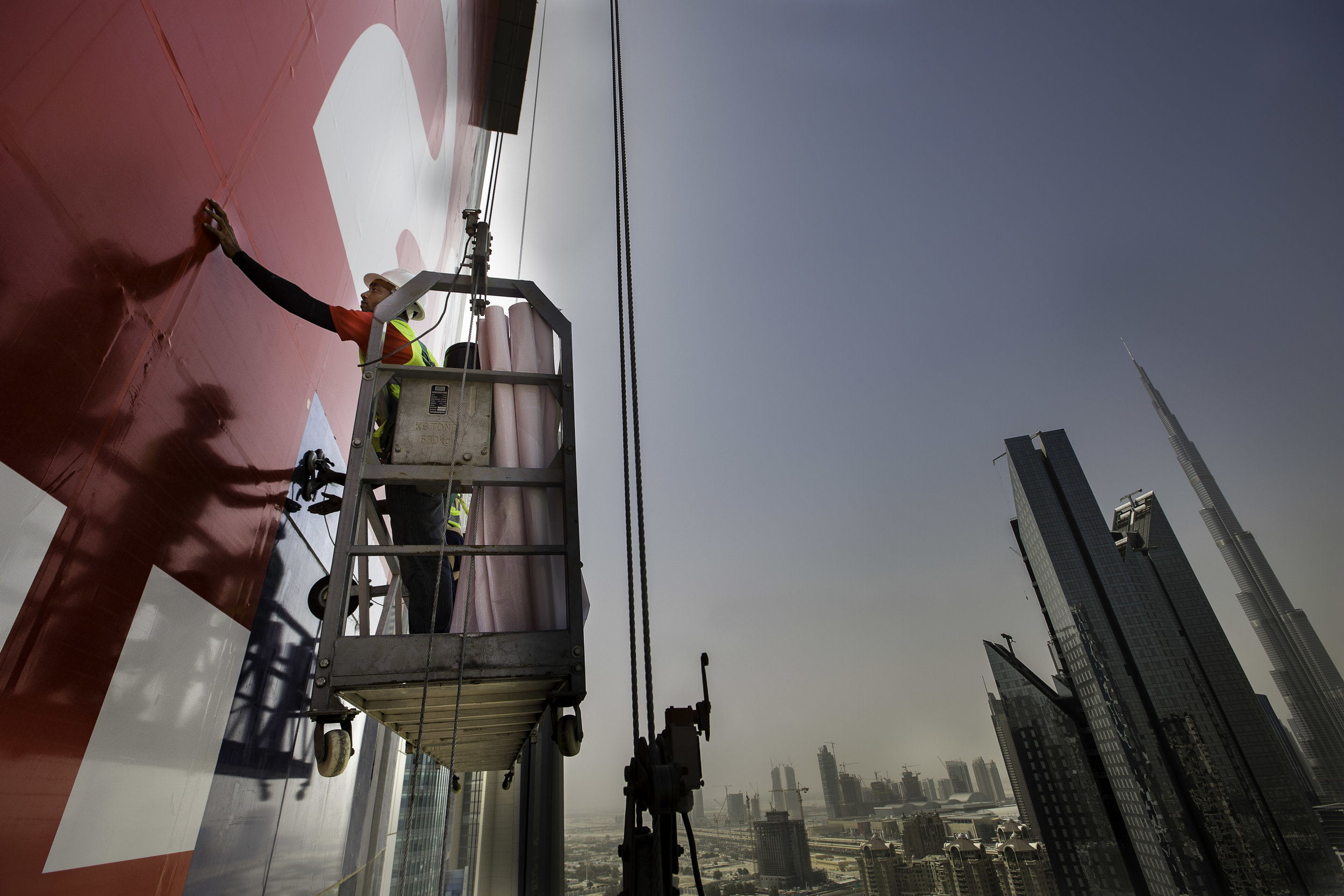 ENG applicators put up an advert on the Warwick Hotel building in Dubai.jpg