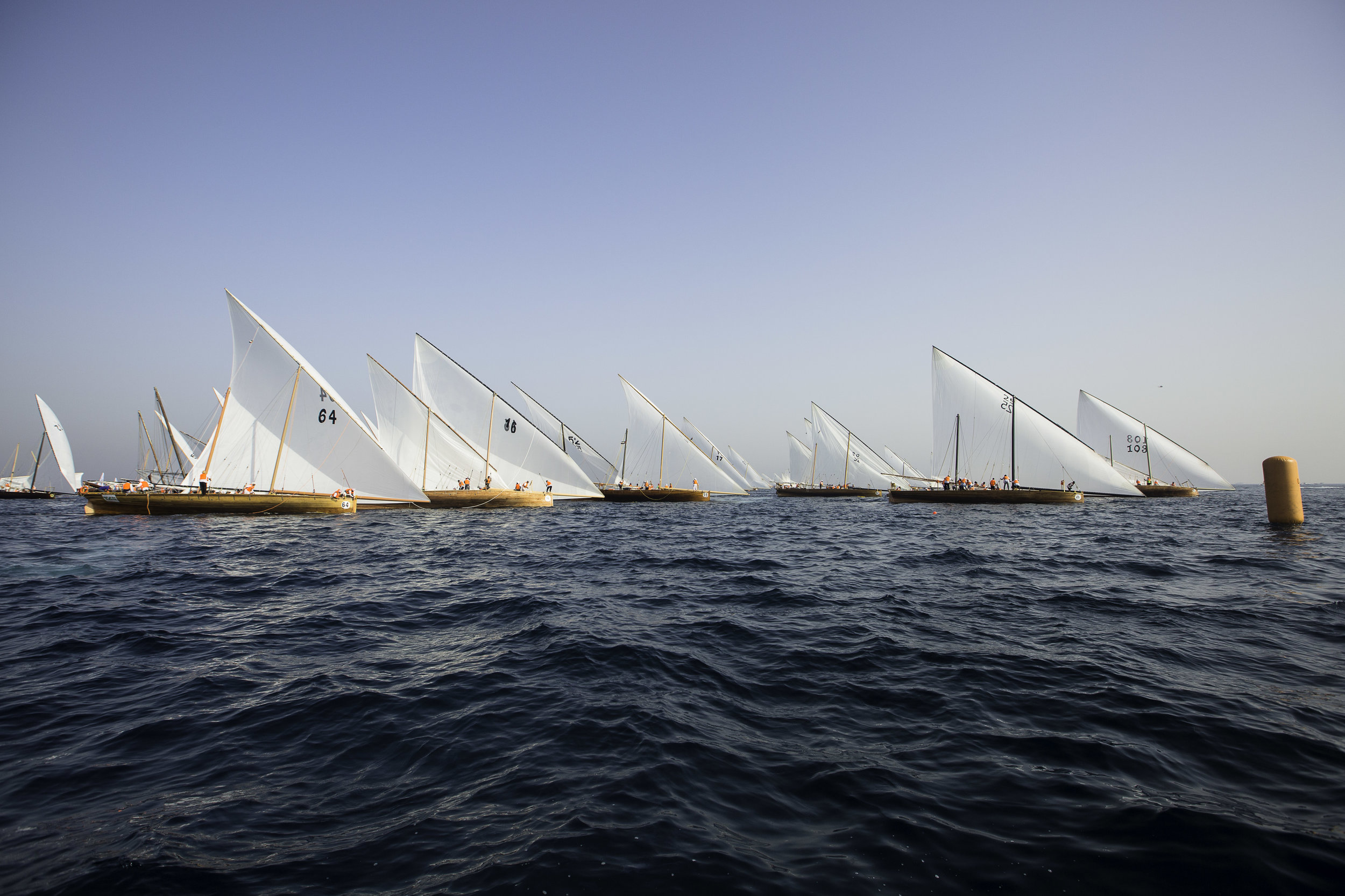 The 120 dhows line up at the start line off Sir Bu Nair Island during the 25th Al Gaffal dhow race (1).jpg