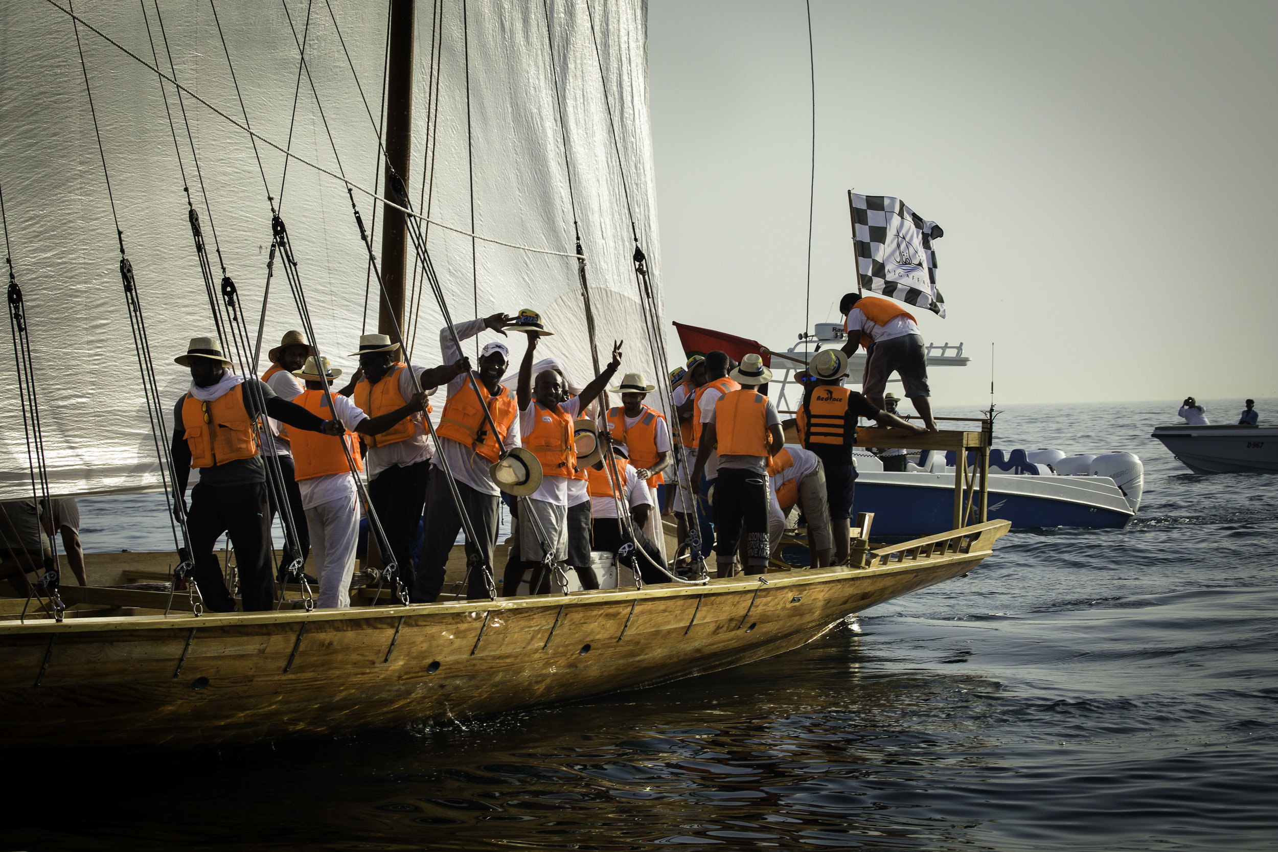 Members of the winning dhow celebrate after learning they had won when the race was cut short..jpg