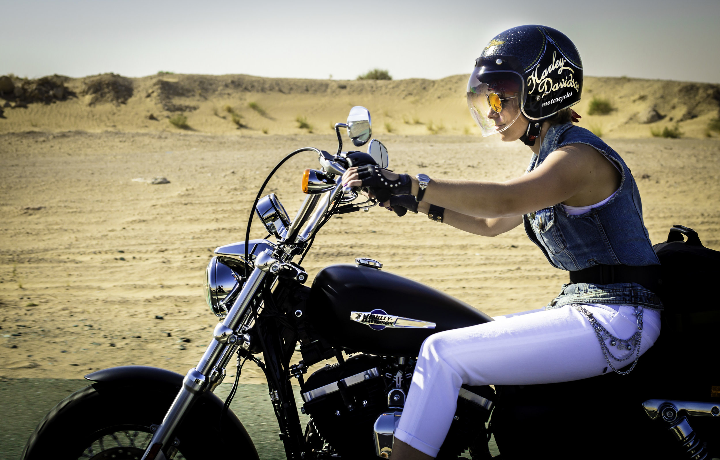 On the road, riding from Dubai toward Al Ain on the International Female Ride Day.jpg
