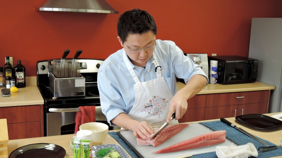 One loin completed, Jun removes the bones from the second loin       of the Katsu Hamachi fillet