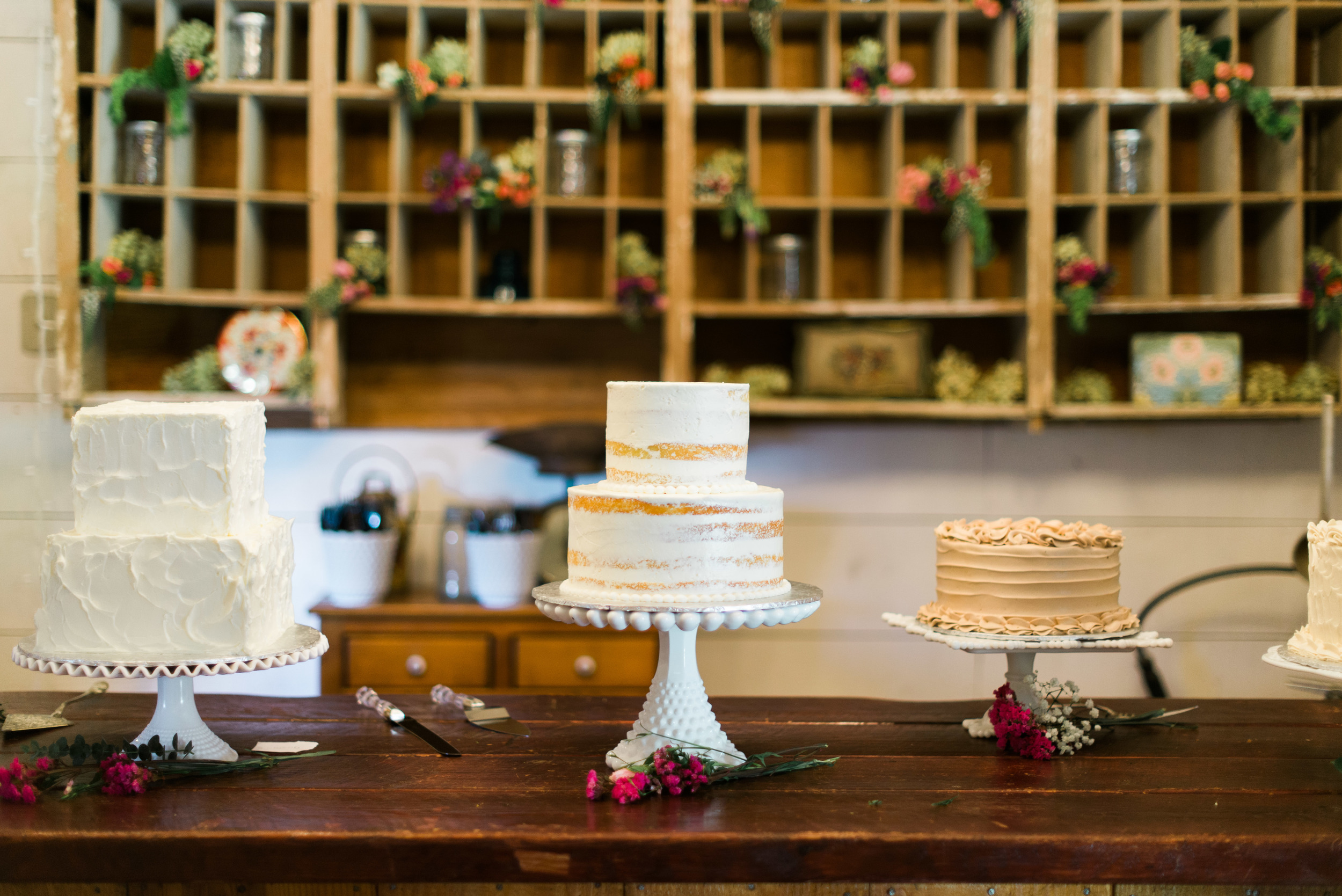 """The cake table was full of beautiful cakes, including this popular """"naked"""" cake."""