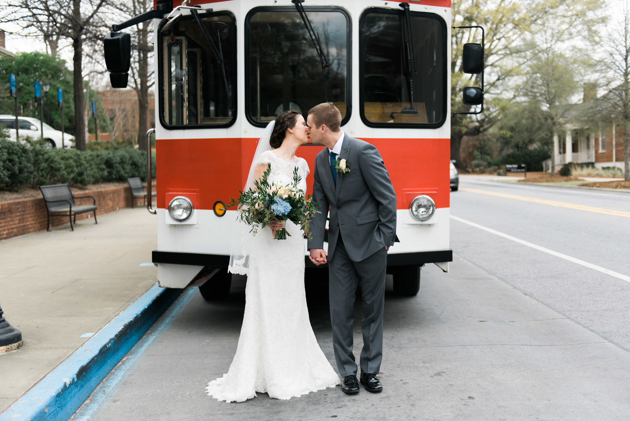 trolley uga bride and groom athens wedding photographer
