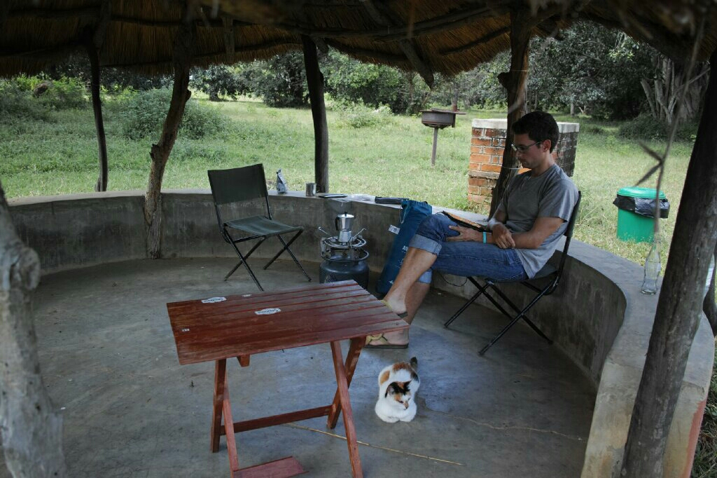 Afternoon reading with the cat at Moorings campsite. Photo: K. Fleurial