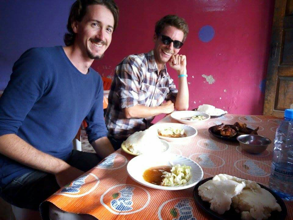 Trying out some yummy Zambian cuisine. Photo: N. Langkamp