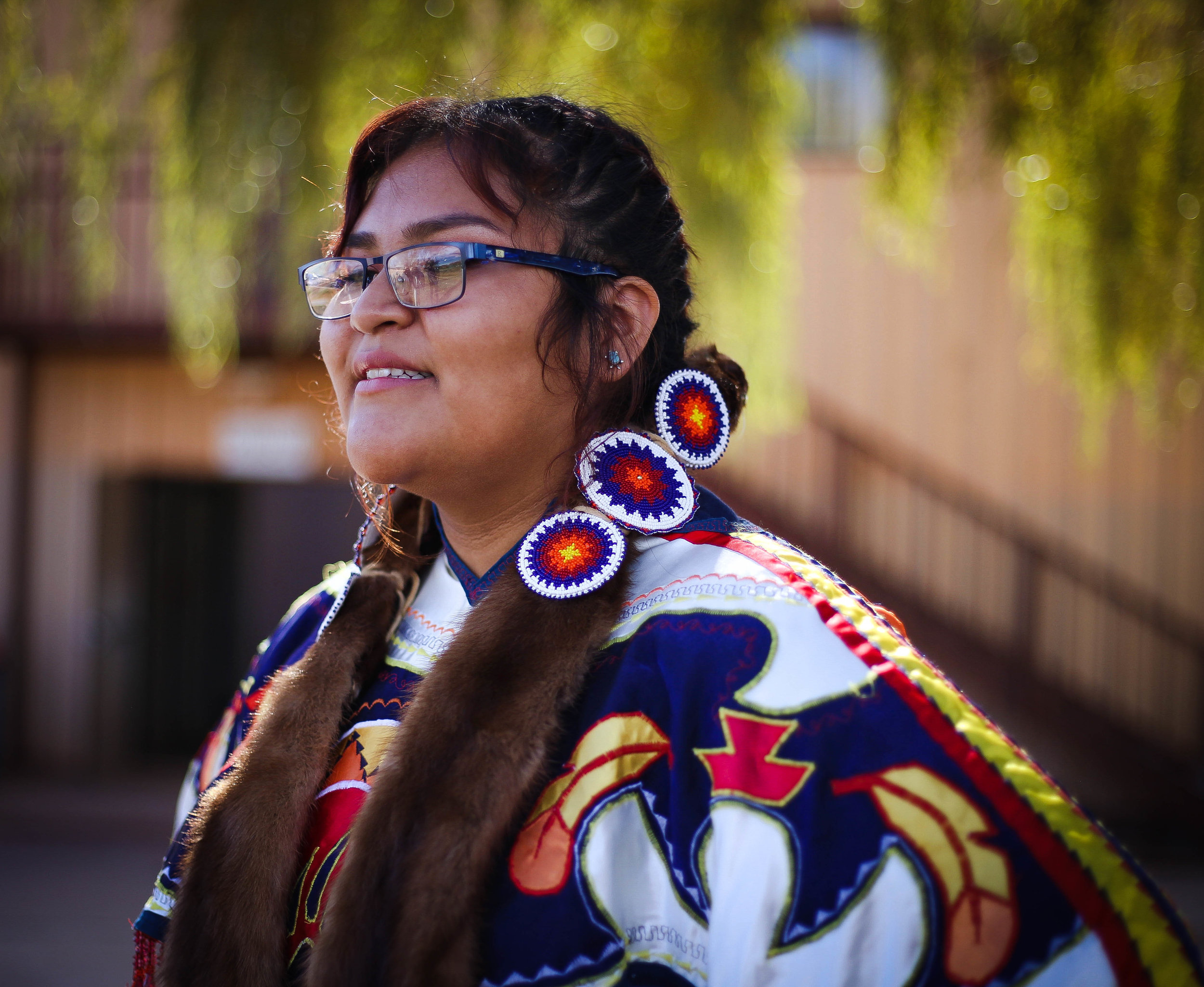 Laqueta, 10th grade, is in her Native regalia performing at our Native Heritage Festival this year.