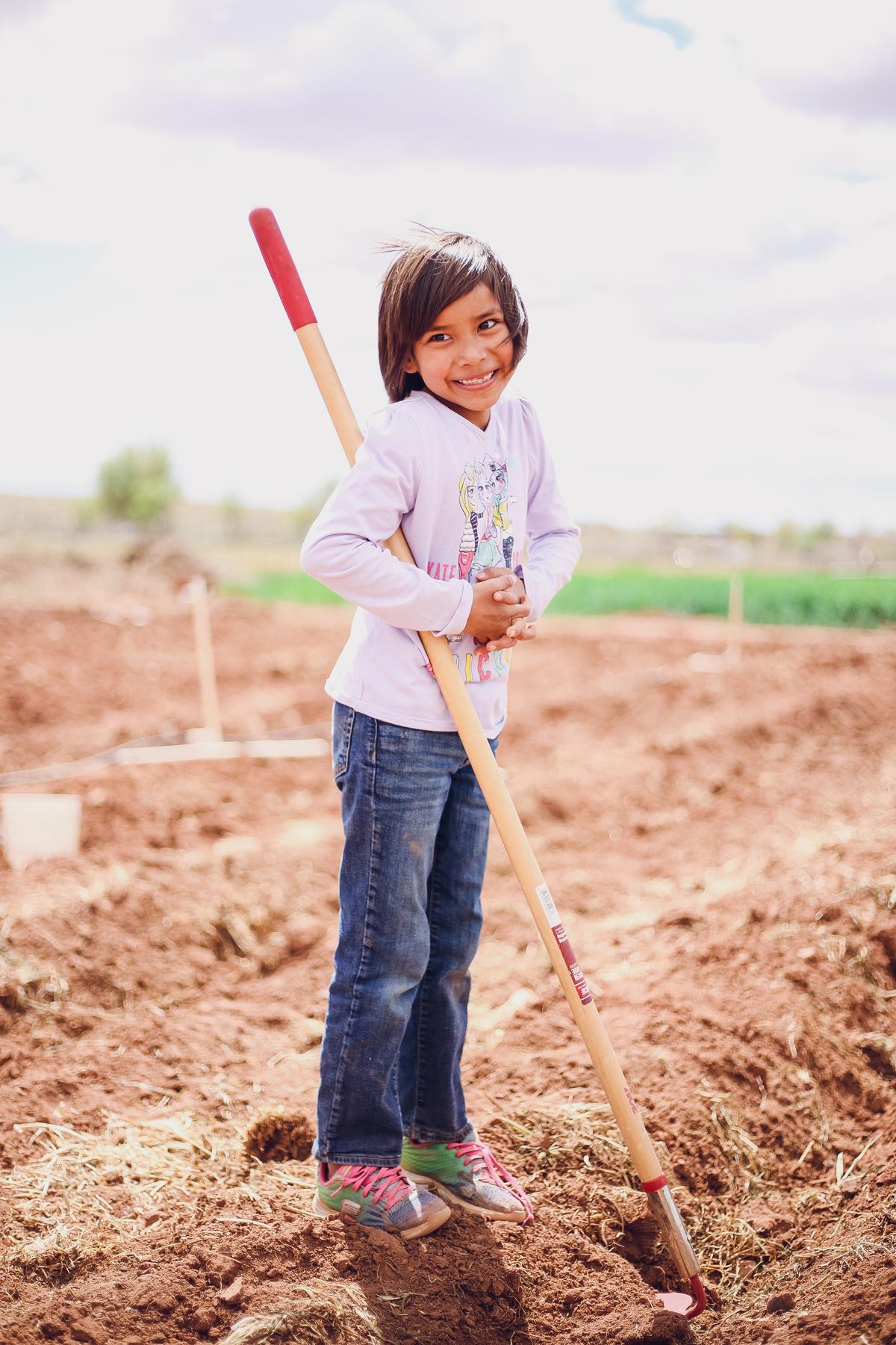 student gardening