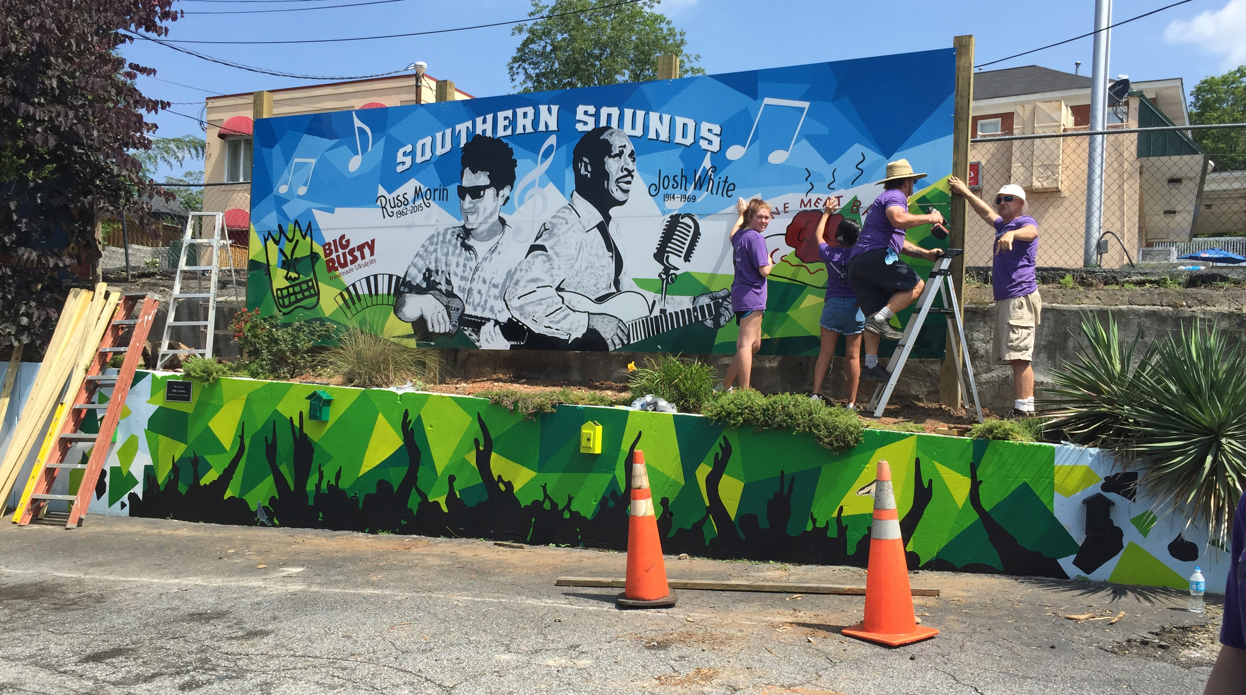 Musicians honored in the Southern Sounds mural: Russ Morin (L) and Josh White (R)