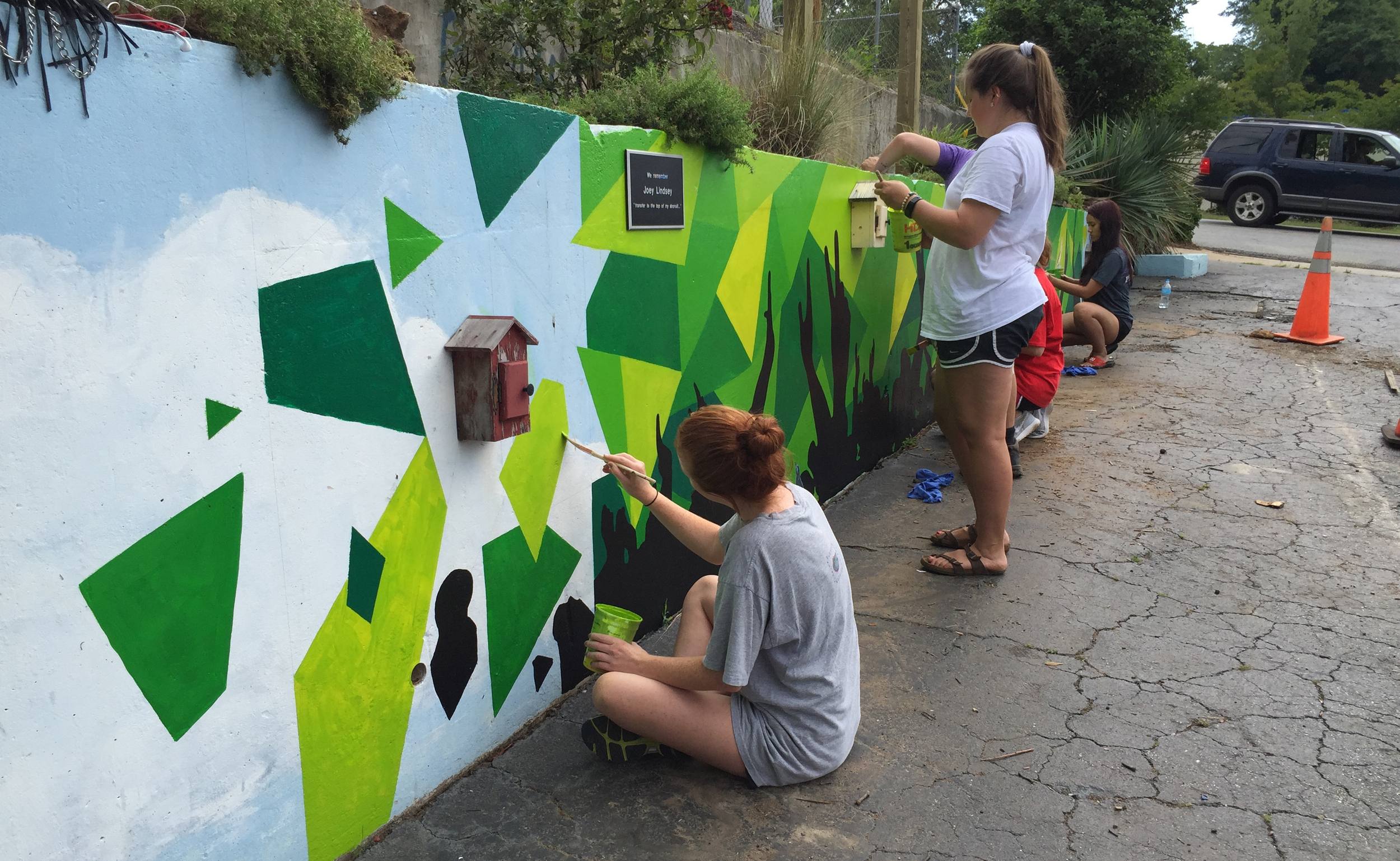 Furman Students working on the base of the Southern Sounds mural