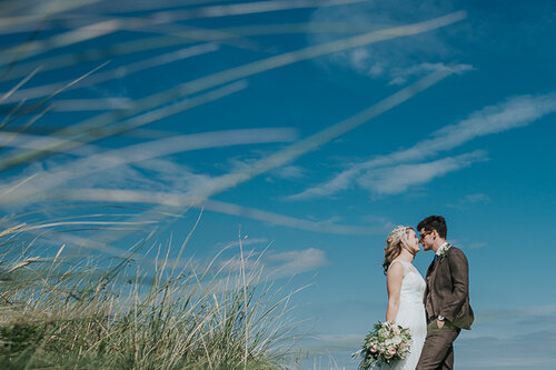 Lauren & Tom - Barn On The Bay - One of our favourite venues, situated on the Northumberland coast was the setting for this beautiful wedding. A ceremony by the beach followed by a party in the barn, with some inquisitive alpacas thrown in for good measure.