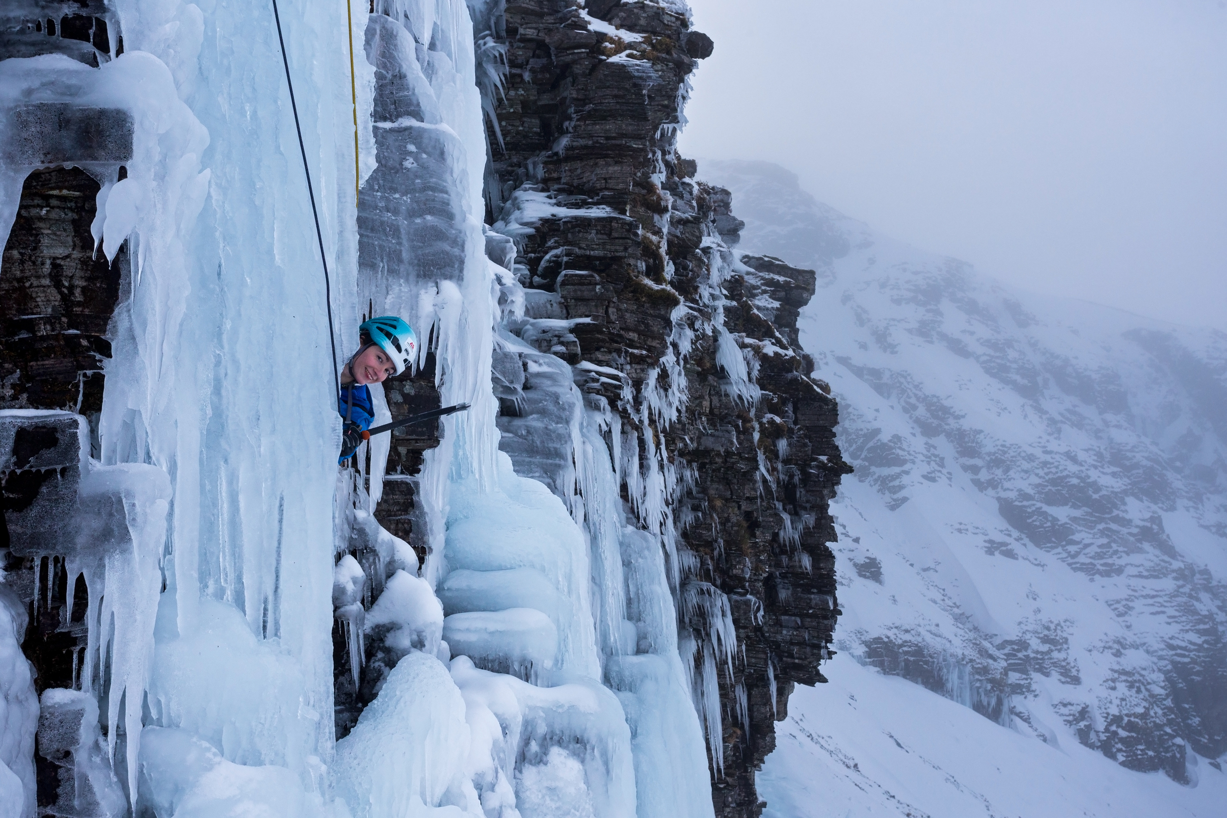 Natalie Berry in the ice cave half way up the route. (Photo: Chris Prescott)