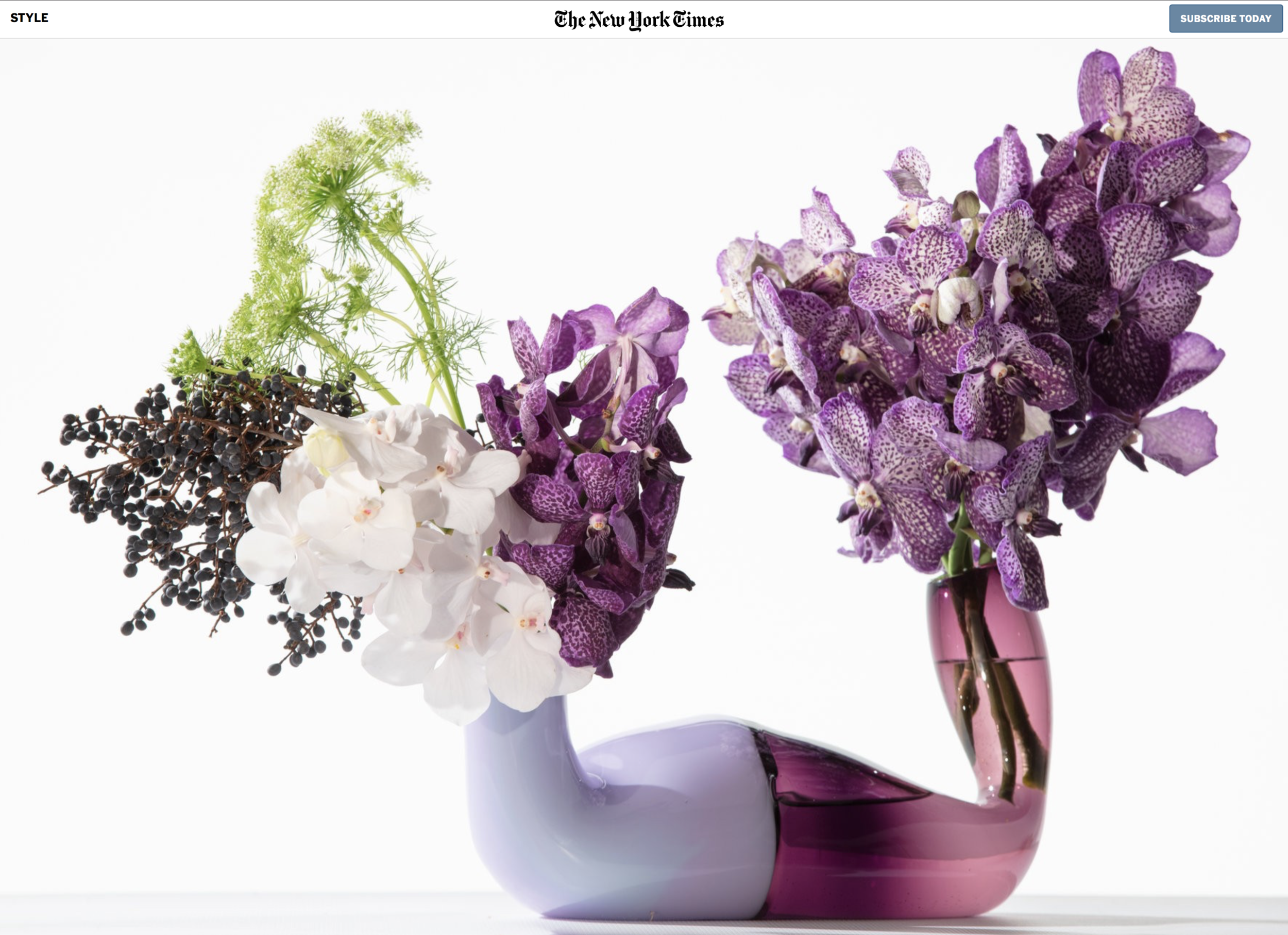 The Pushmepullme vase by Andi Kovel and Justin Parker of Esque Studio. On the purple side, dark purple Vanda diamond orchids. On the lavender side, white Vandas, with Queen Anne's lace and blackberries. $2,200; esque-studio.com.CreditTony Cenicola/The New York Times