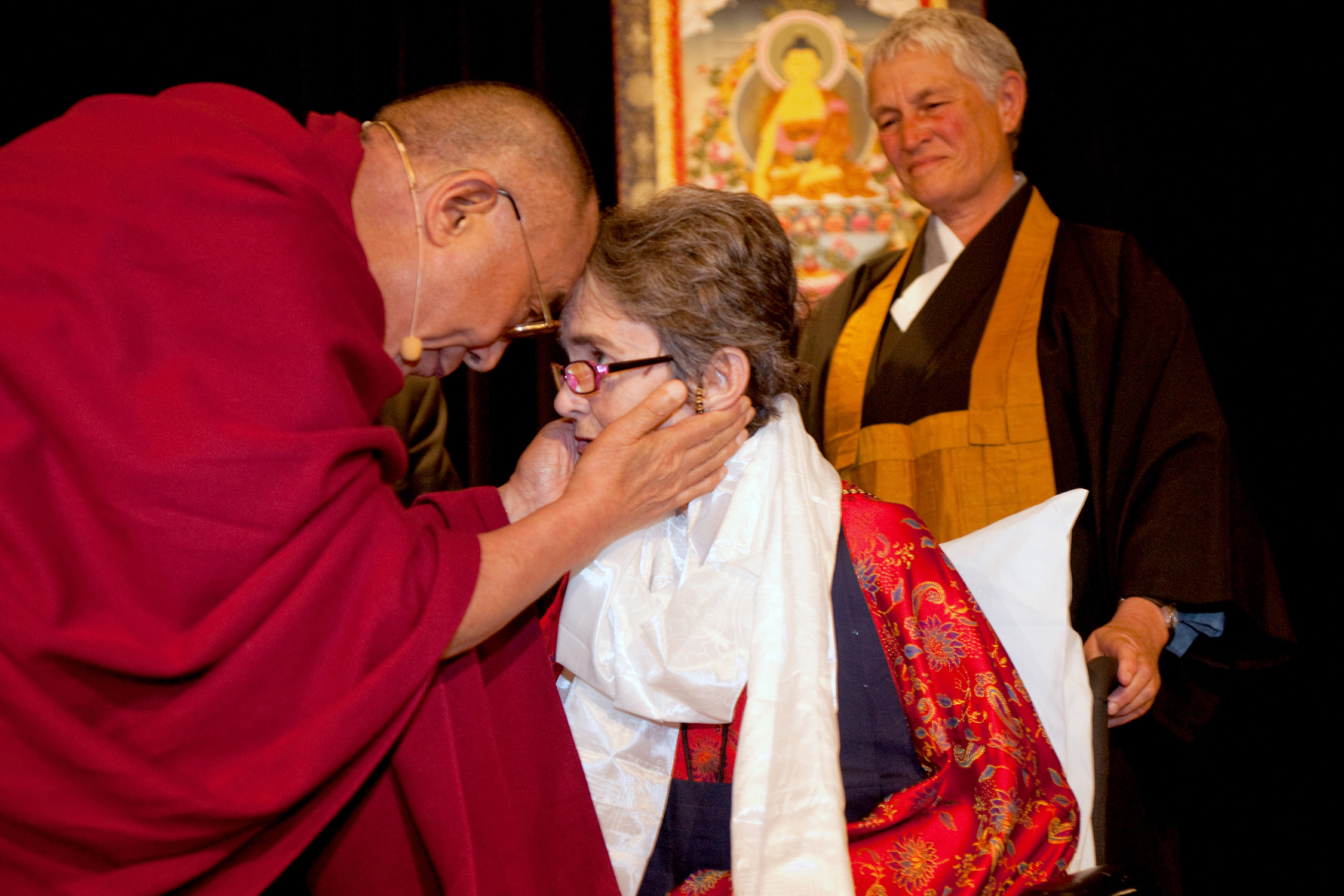 Dr. Grace Dammann with the Dalai Lama at the Unsung Heroes of Compassion award ceremony in 2009. Dammann was honored for her work as the co-founder of one of San Francisco's first HIV/AIDS clinics for poor people during the disease's deadliest era. She later survived a near-fatal head-on collision on the Golden Gate Bridge. The new feature-length documentary  States of Grace  by filmmakers Helen S. Cohen and Mark Lipman chronicles her journey following the accident. Photo credit: Michael Yamashita