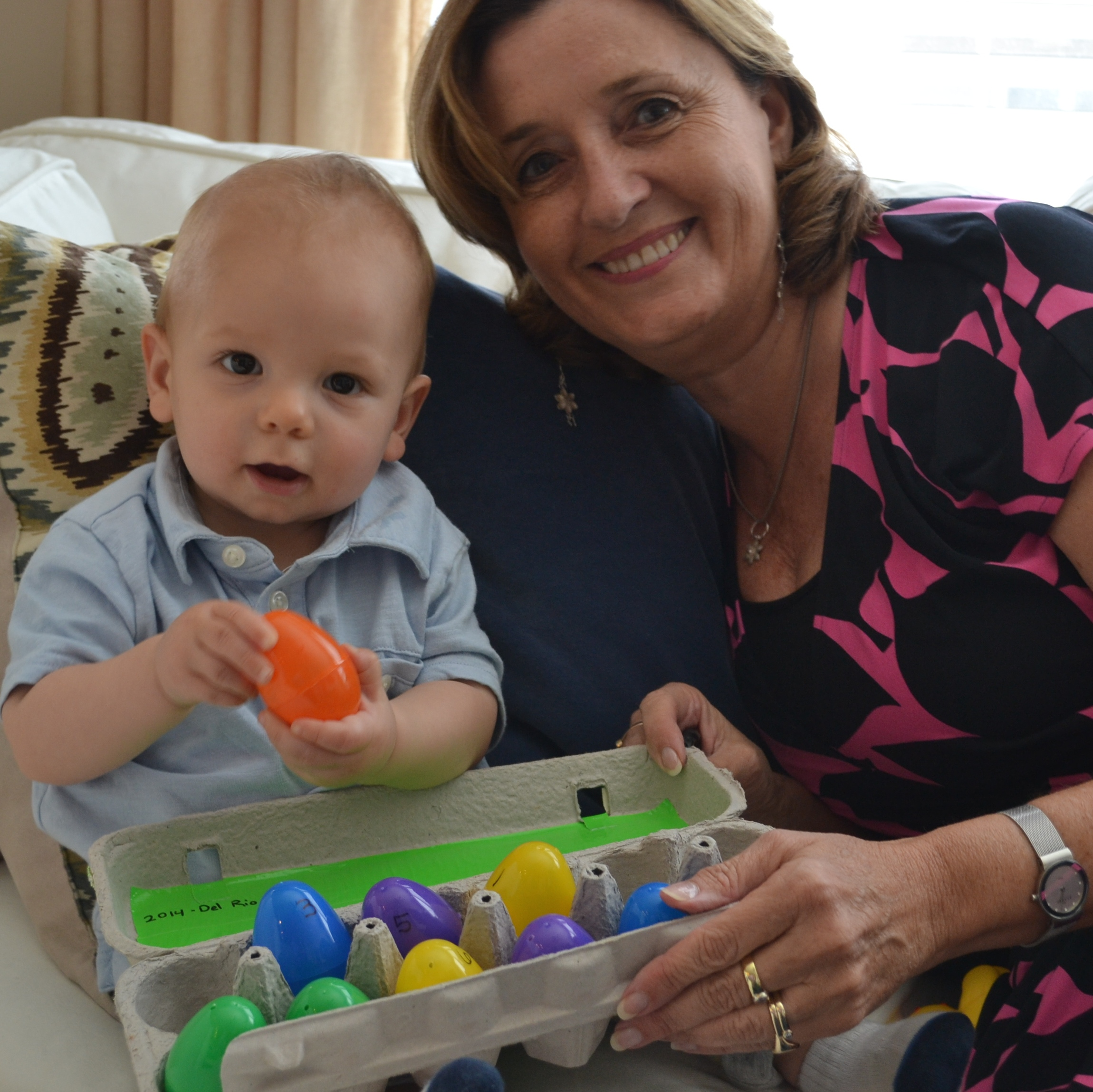 Lyn and grandson with easter story eggs