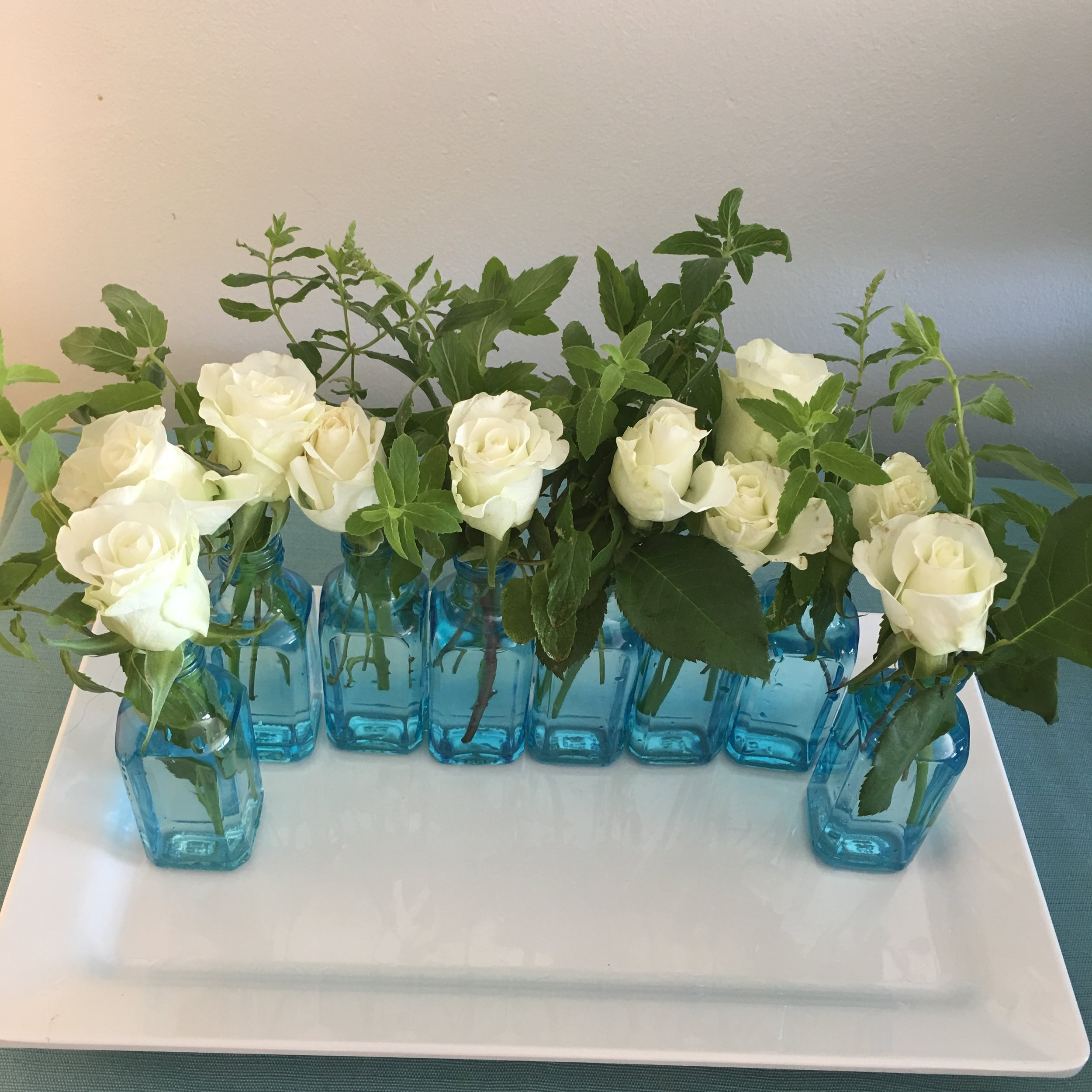 Small bottles with flowers