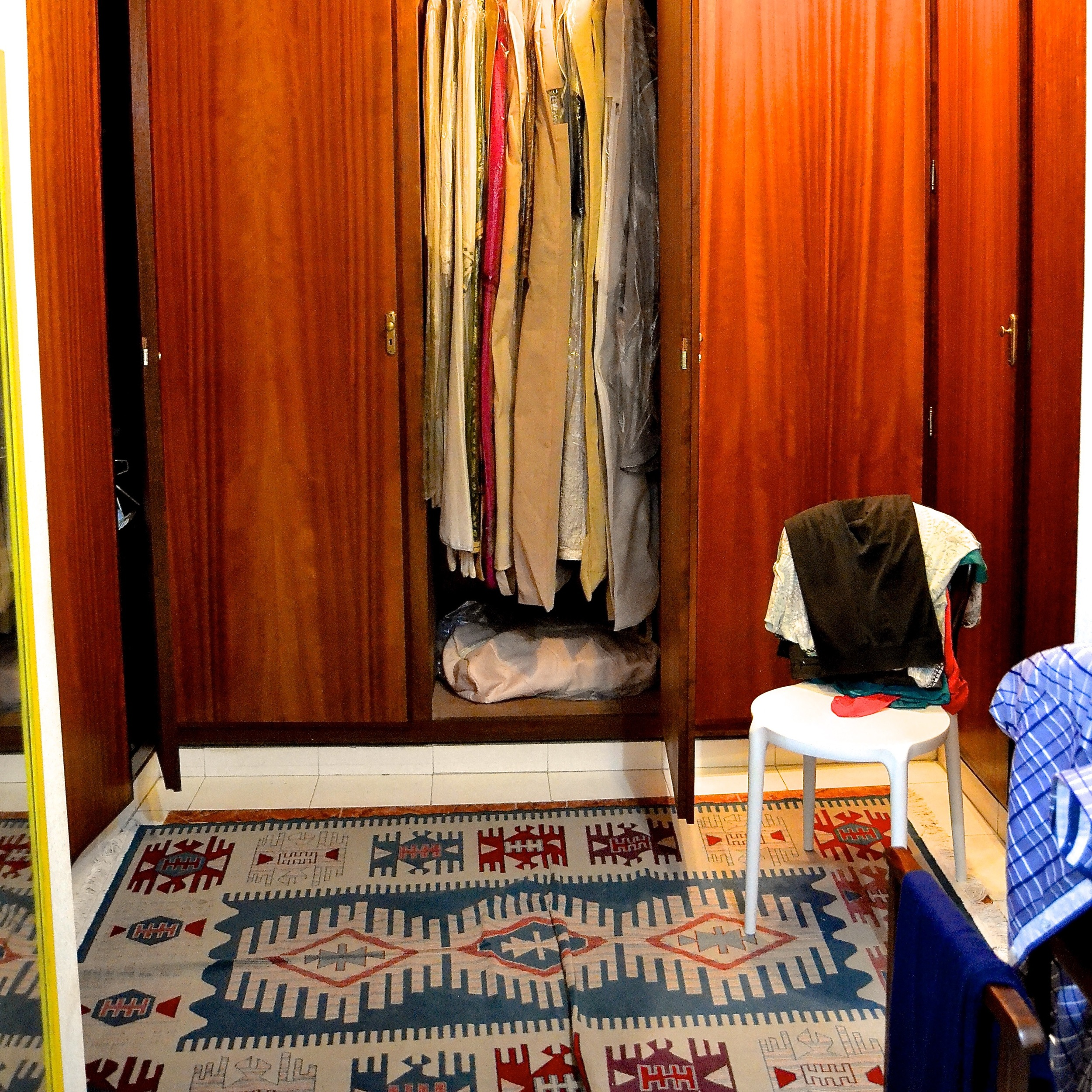 Thouria's dressing room is anchored by a traditional woven rug.