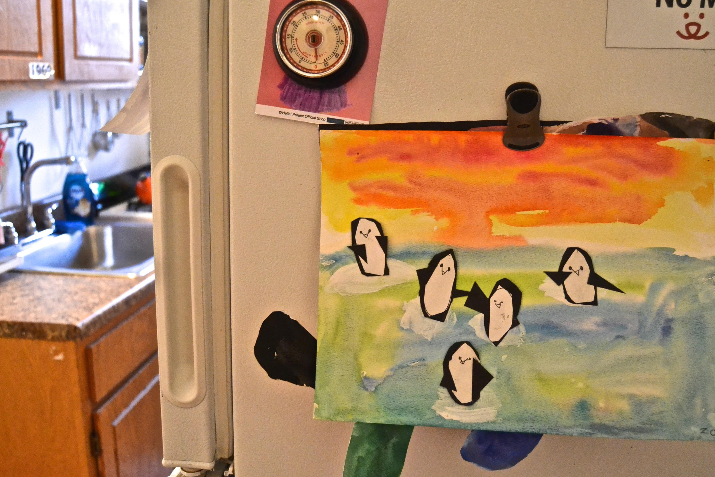 Upon entering the space, one is greeted by the happiest of penguins.