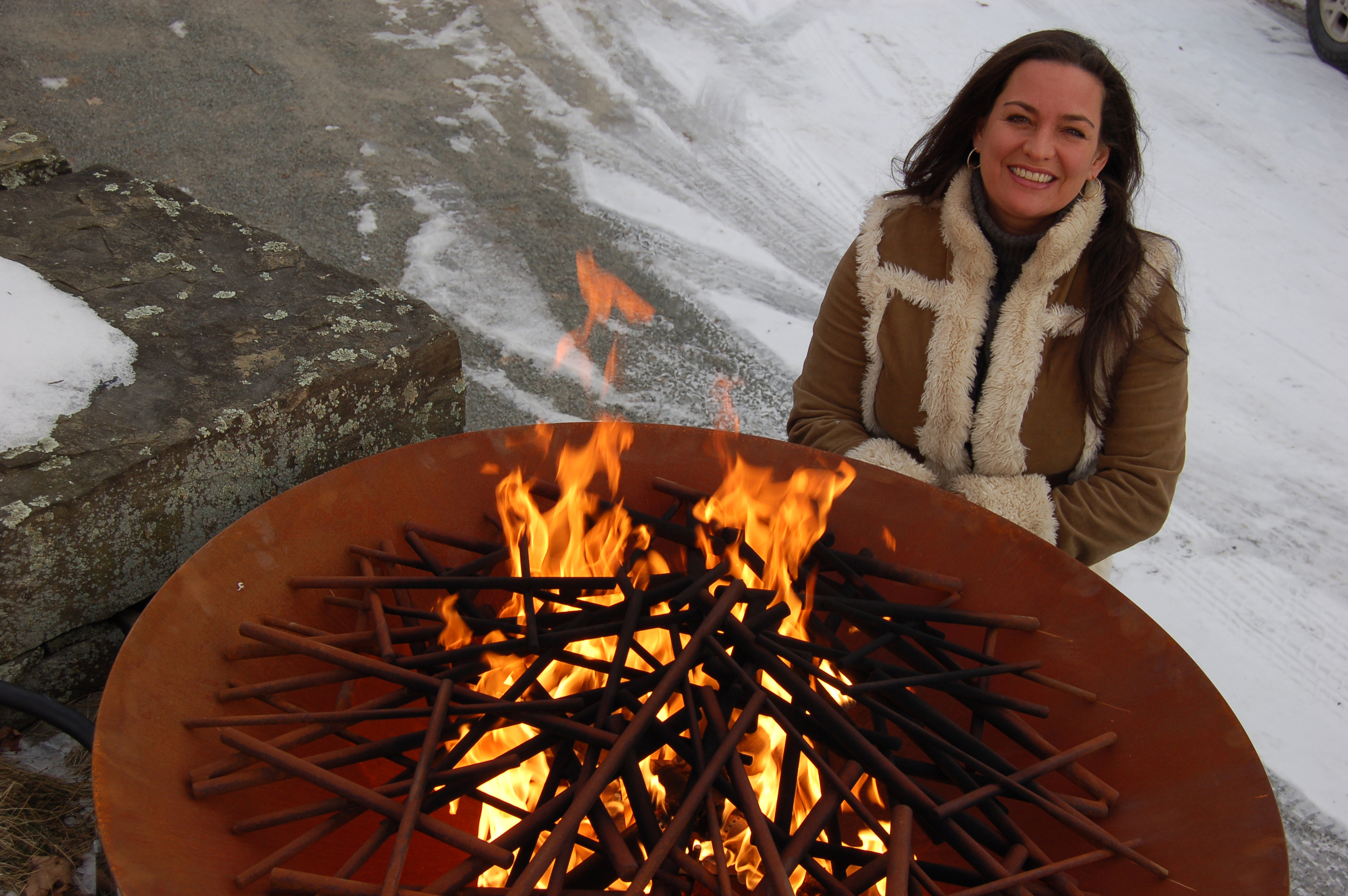 Elena Colombo takes off the winter chill. She's pictured here with her corten steel firebowl with branch insert.