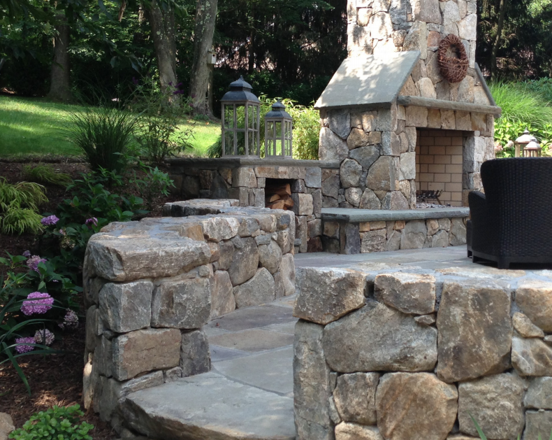 outdoor fireplace by William Einhorn—a landscape architect licensed in NY, CT, and NJ, and the owner of LDAW Landscape Architecture and Aqua-Scape Pools in Carmel, NY