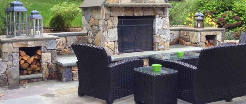 Patio by outdoor fireplace by William Einhorn—a landscape architect licensed in NY, CT, and NJ, and the owner of LDAW Landscape Architecture and Aqua-Scape Pools in Carmel, NY