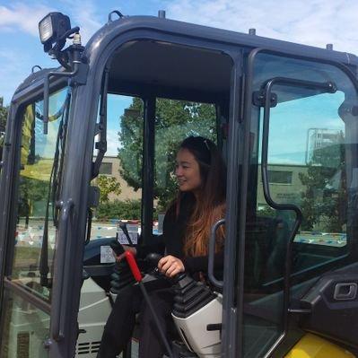 Kate operating heavy equipment.