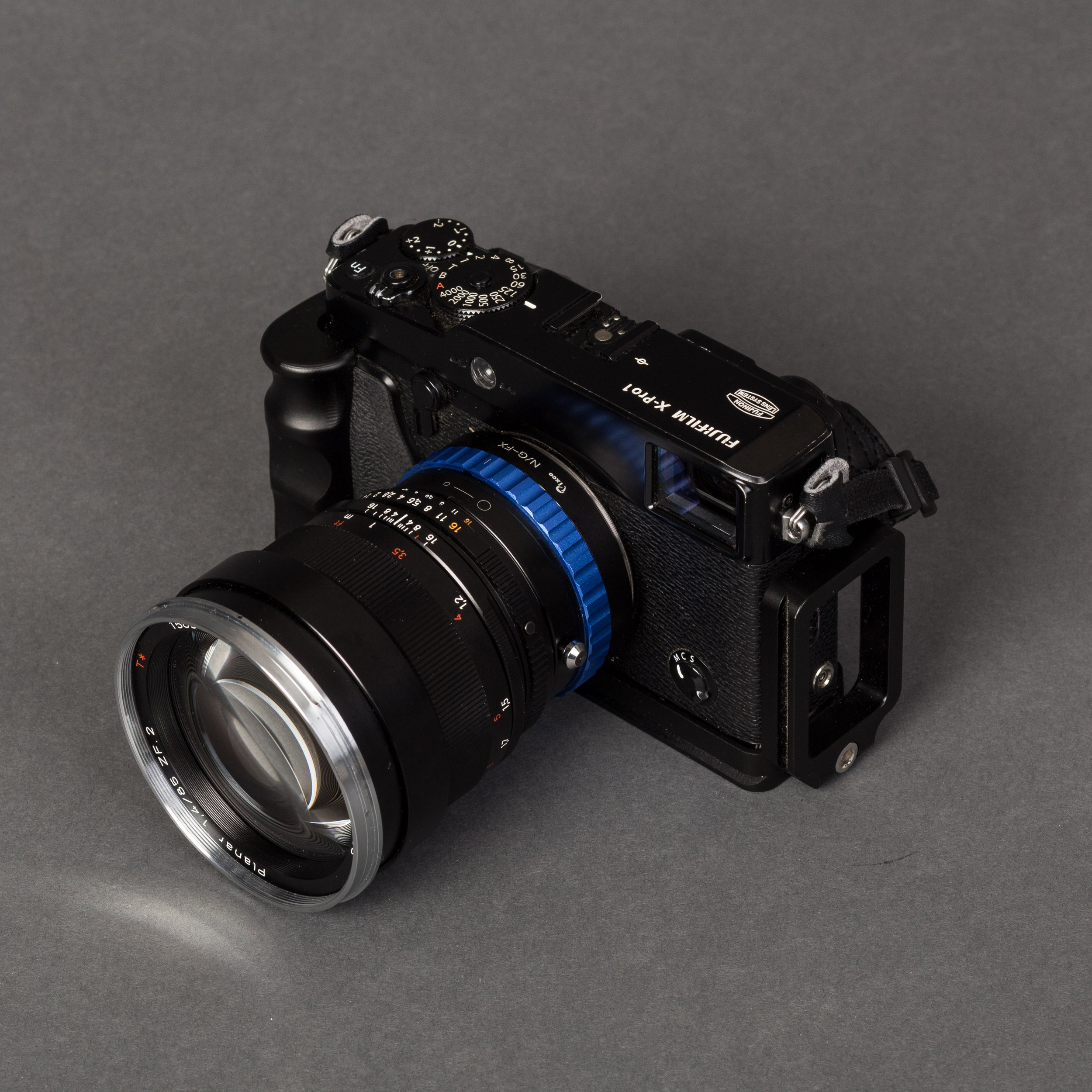 X-Pro 1 with the 85mm and and an Arca Swiss L bracket grip.
