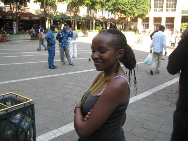 My cornrowns doe! This was before your girl discovered natural hair. ION, those men's poses behind me are just too dope!