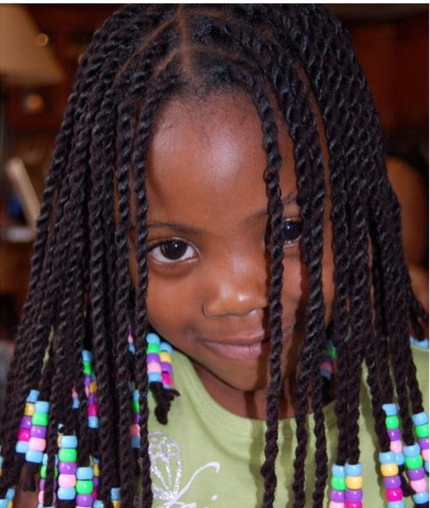 This is an example of a simple but cute protective style that you can try out for your daughter.  PC: www.blackmomsblog.com