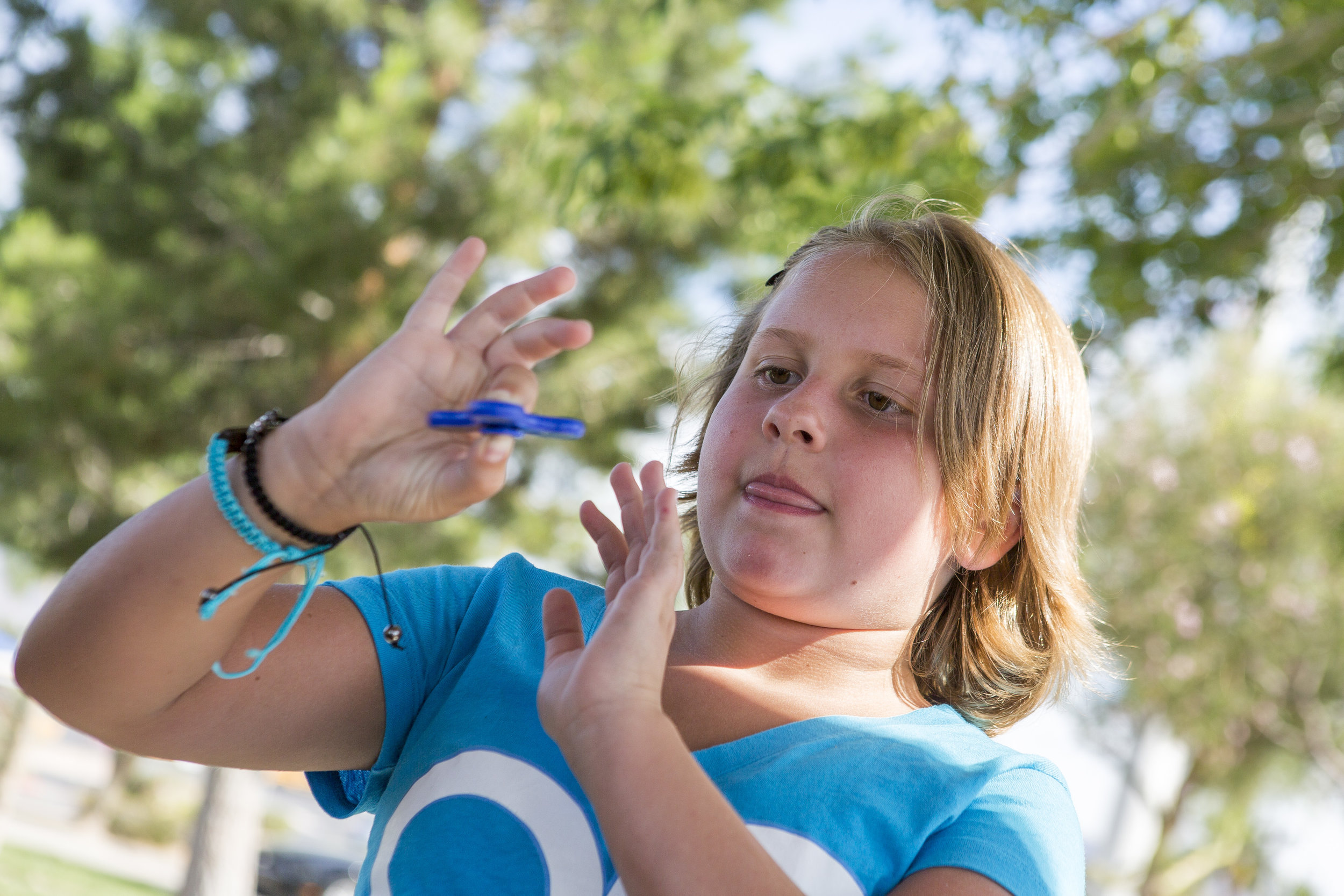 Tayler Rexroad, 8, plays with her fidget spinner at Stephanie Lynn Craig Park in Henderson on Monday, May 22, 2017. Fidget spinners have been the source of scrutiny by some school teachers and officials, some of whom have banned the toys. Patrick Connolly Las Vegas Review-Journal @PConnPie