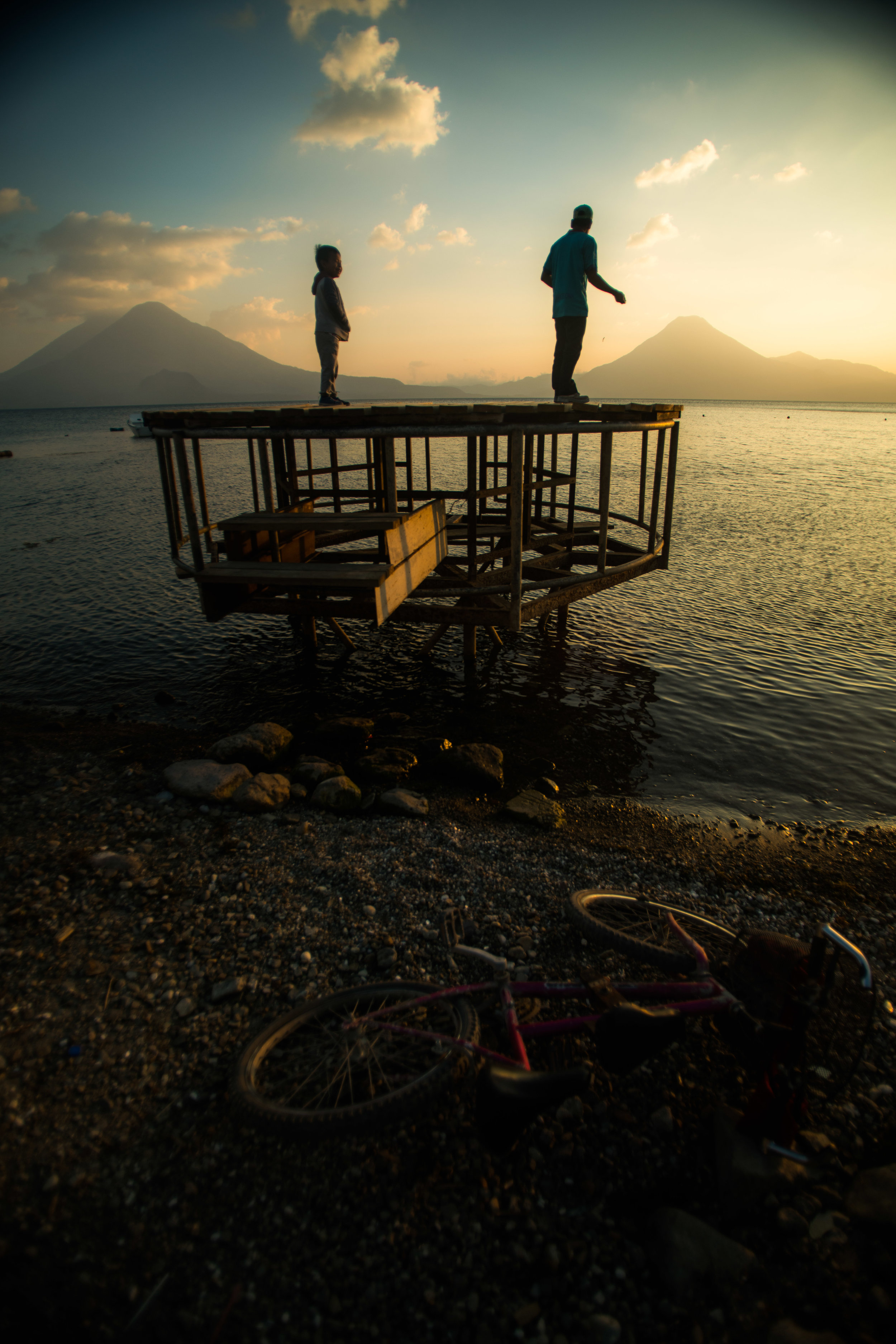 Local father and son fishing during sunset on Lake Atitlan from Panajachel