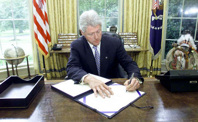 Bill Clinton signs the Defense of Marriage Act in 1996.