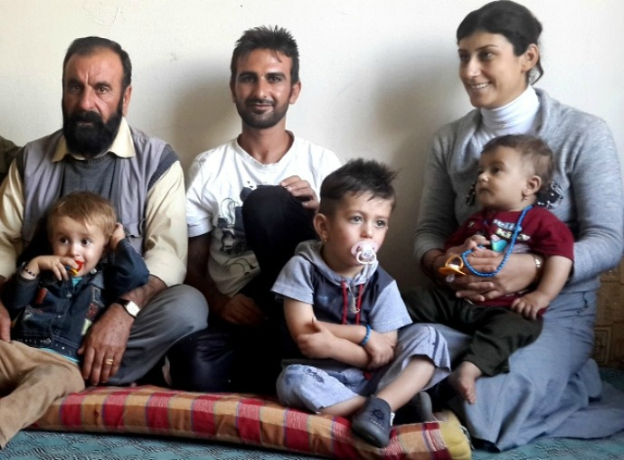 Yazidi interpreter Farhan Mahlo with his family