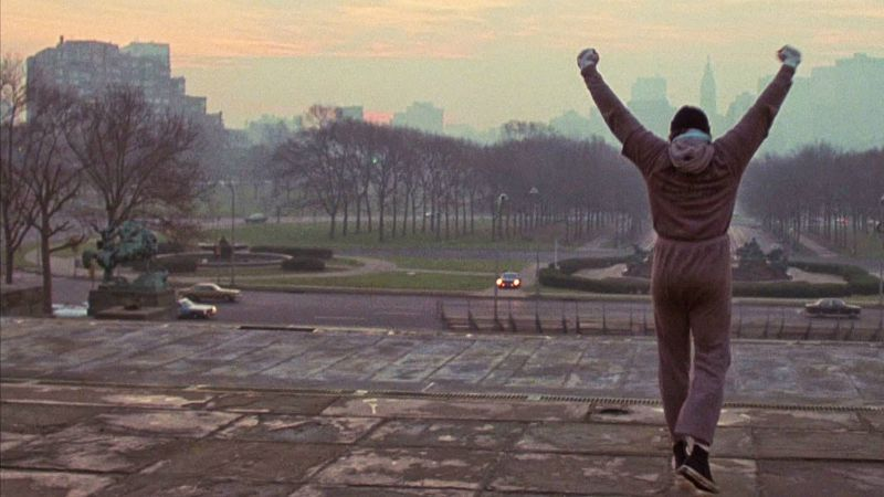 Rocky Balboa (Sylvester Stallone) reaches the top of the stairs in the iconic training montage from the original Rocky (Image  ©  United Artists).