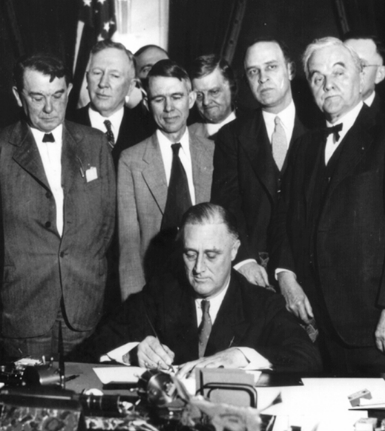 FDR signs the Tennessee Valley Authority Act of 1933.