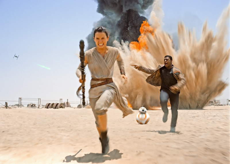 Rey (Daisy Ridley) and Finn (John Boyega) run from danger for the first (but far from the last) time in  Star Wars: The Force Awakens (Image  © Lucasfilm).
