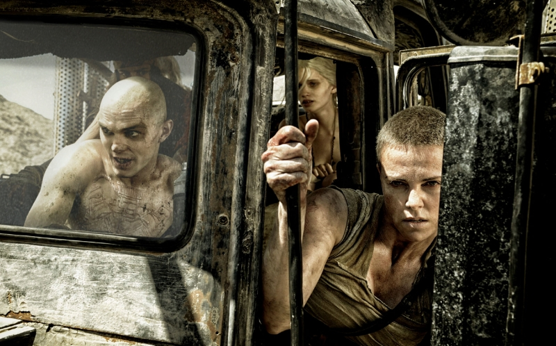 Nicholas Hoult, Rosie Huntington-Whiteley, and Charlize Theron in George Miller's  Mad Max: Fury Road  (Image © Warner Bros.).