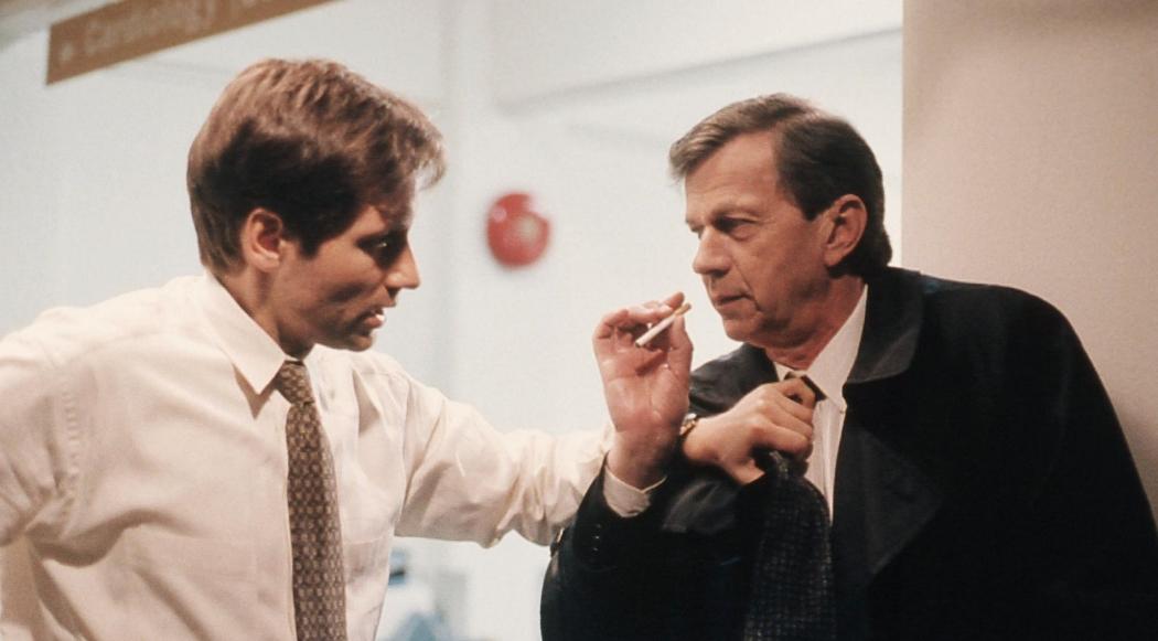 FBI Agent Fox Mulder (David Duchovny) confronts the infamous Cigarette Smoking Man (William B. Davis). Image  ©  20th Century Fox.