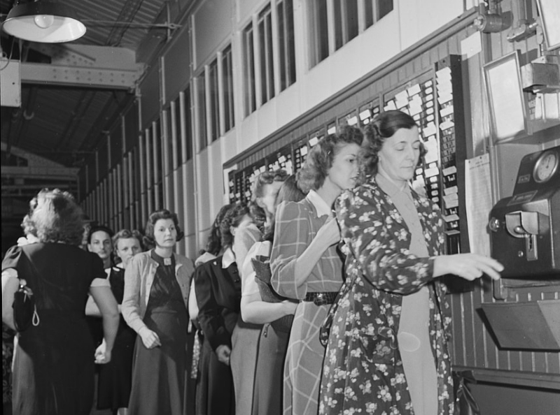 Factory workers punching the clock in the 1940's.