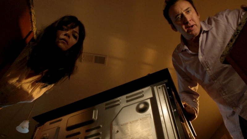 Selma Blair and Nicolas Cage (Image © Momentum Pictures)