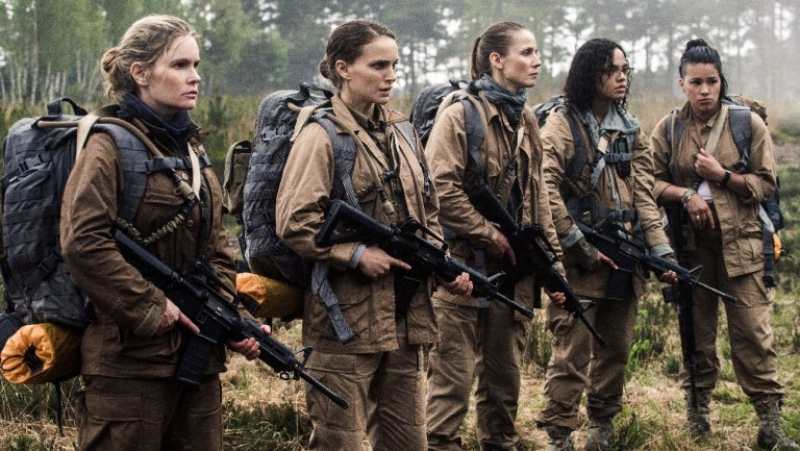 "Jennifer Jason Leigh, Natalie Portman, Tuva Novotny, Tessa Thompson, and Gina Rodriguez prepare to enter ""The Shimmer"" in Annihilation (Image © Paramount Pictures)"