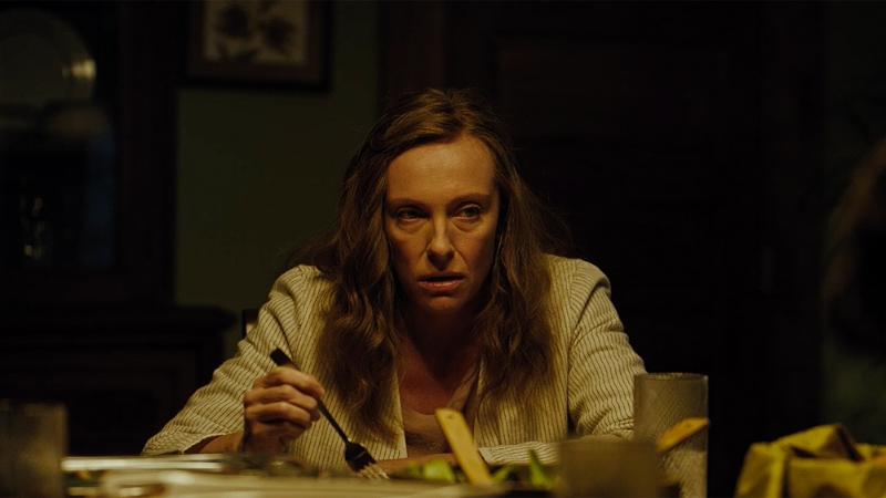 Kolleen's expression reading positive reviews of Hereditary (Image © A24)