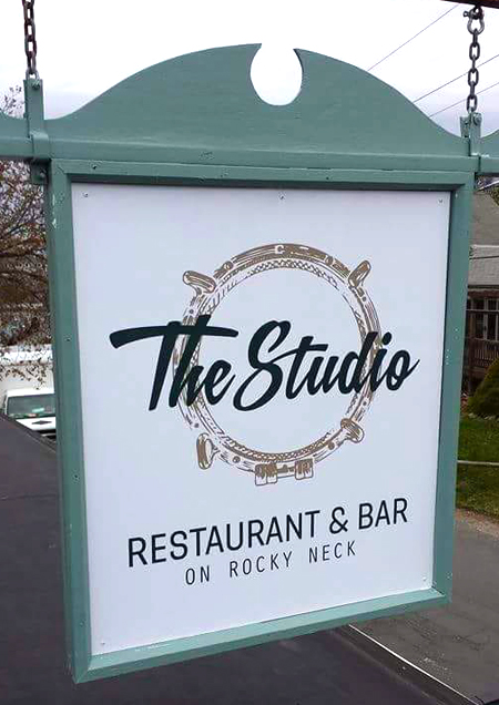 thestudio_restaurant_hangingsign.jpg