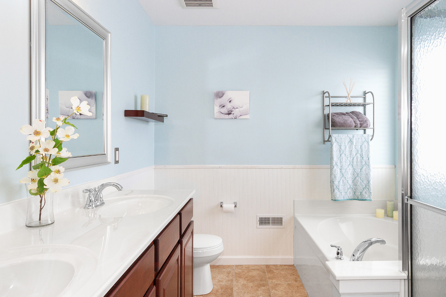 bathroom-with-soft-light-blue-walls-picture-baby-flowers-jason-lusk-portfolio.jpg