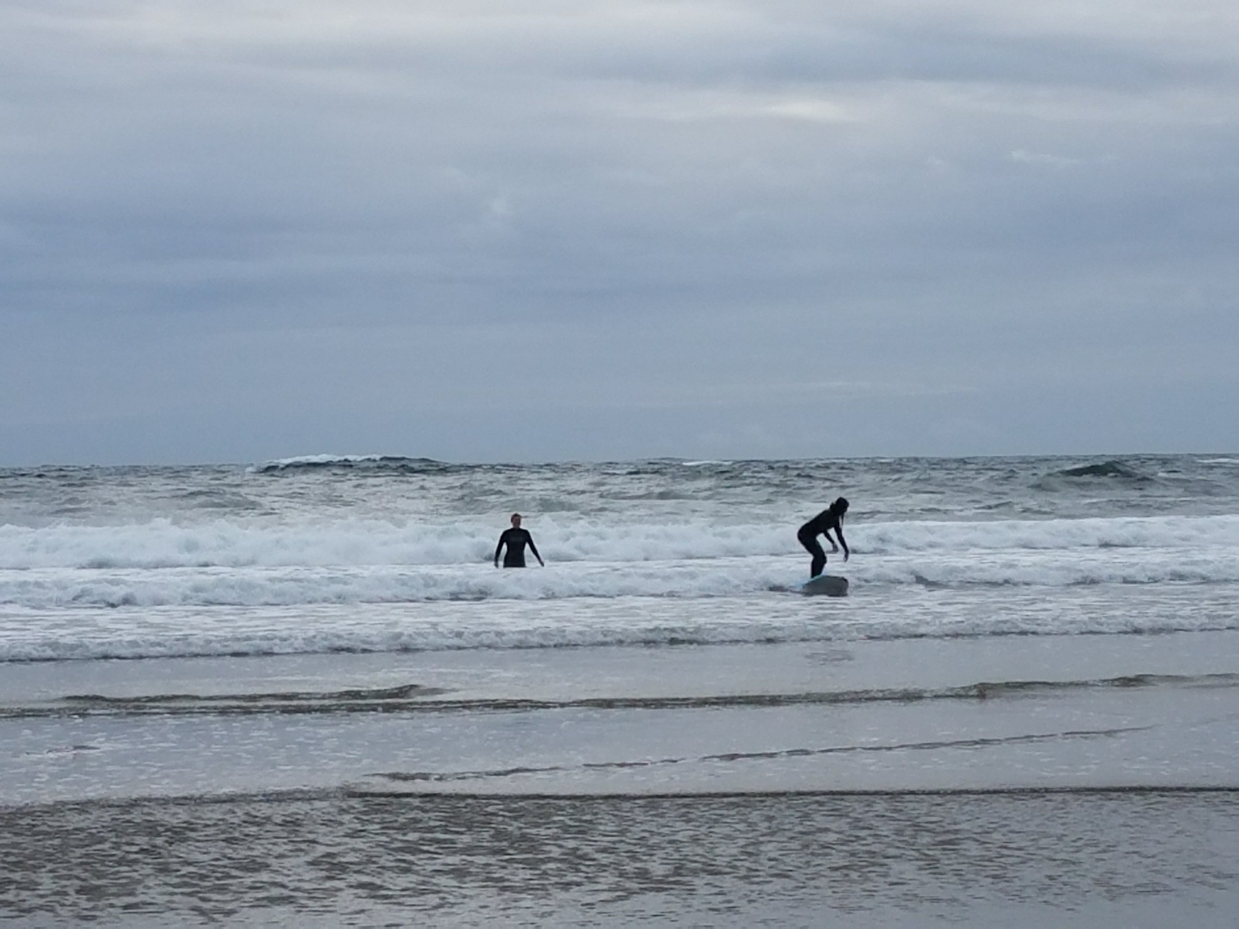 She can surf somewhat, me on the left on the other hand...