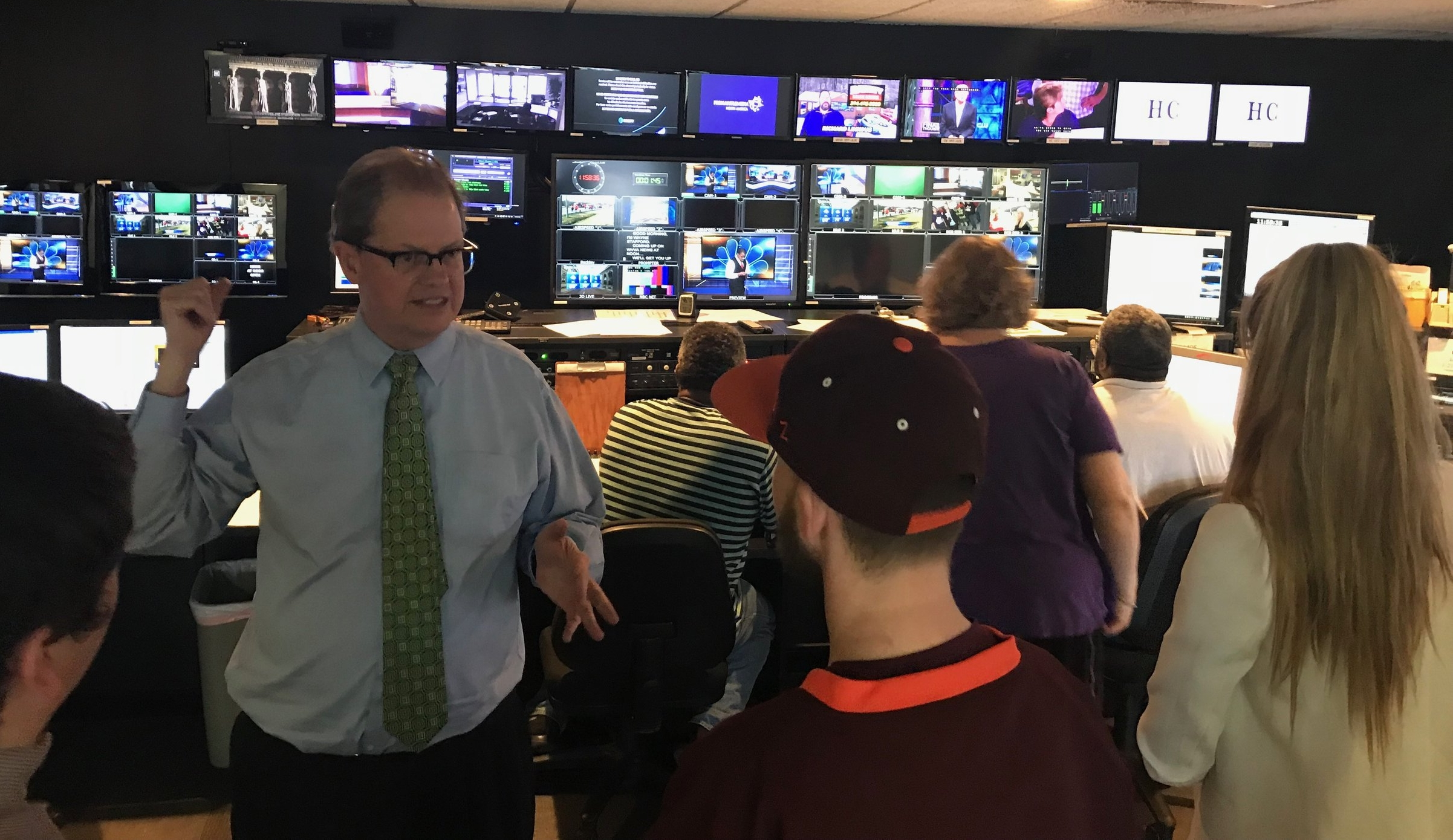 WVVA-TV News Director Ken White walks through the noon news from the station's control room.