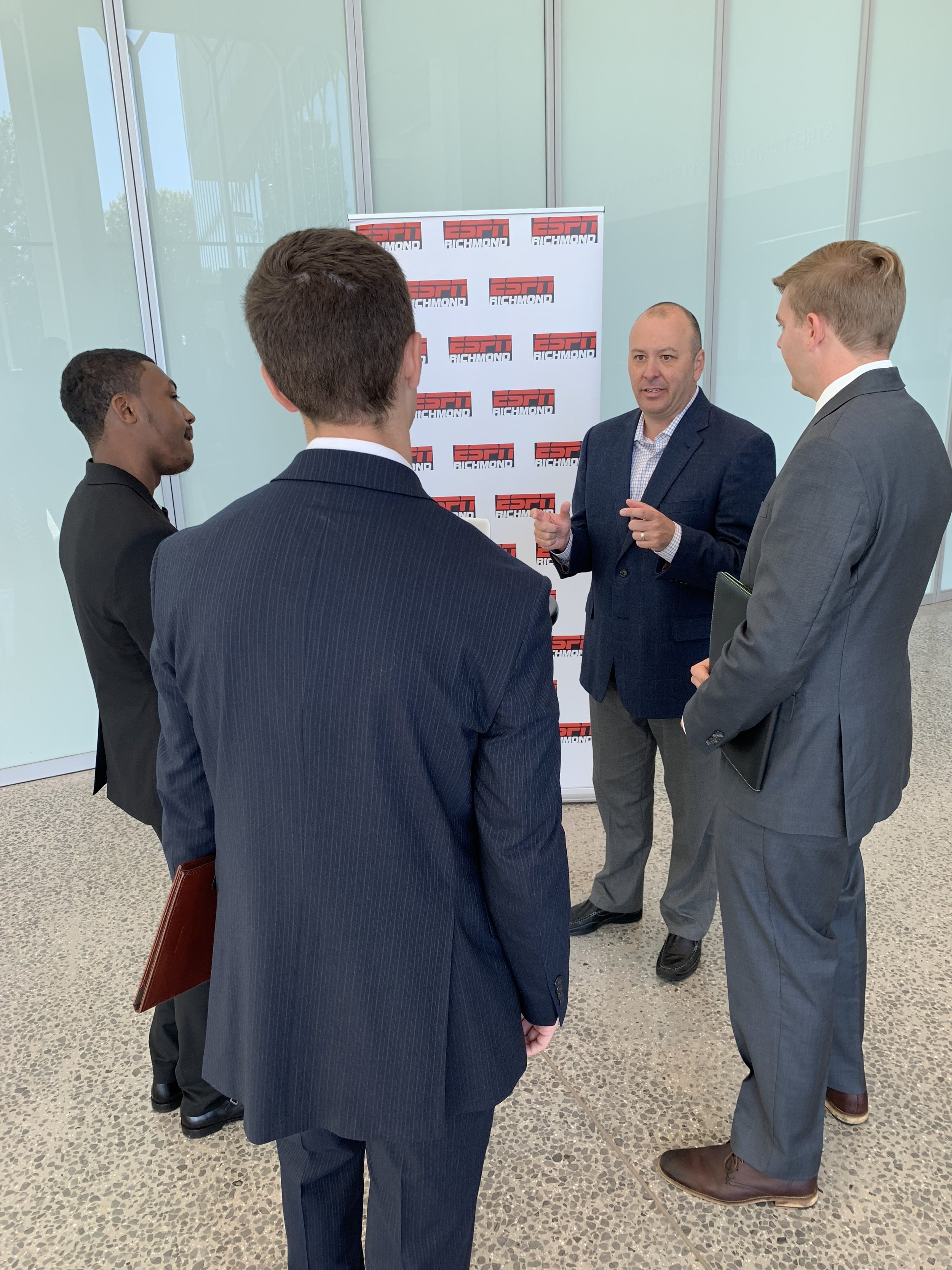 Greg Burton of ESPN Radio in Richmond, Virginia visits with Virginia Tech students at the Virginia Tech Communication Department 2018 Career Fair.